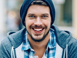 Young man sharing attractive smile