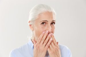 older woman gum disease and facial shape issues