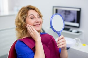 older woman happy with dental implants